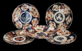 Five Small Antique Imari Plates of Lobed shape, decorated in traditional Imari colours and designs.