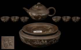 Chinese Brown Pottery Tea Pot and Round Stand with six cups;