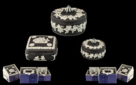 Black Wedgwood Jasper Candy Boxes three pieces to include a candy box round with white leaf