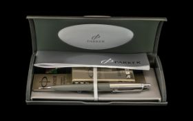 Boxed Parker Pen in silver grey with cartridges and original receipt, in hard shell case.