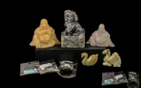 Small Collection of Chinese Carvings comprising a foo dog, two carved agate figures of Buddha,