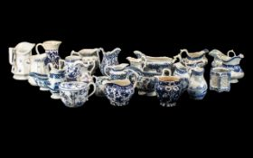 Twenty-five Antique Blue and White Pottery Jugs and Gravy Boats,