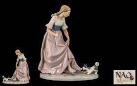 Nao by Lladro Large Hand Painted Porcelain Figure ' Girl with Small Terrier ' c.1990's. Height 11.
