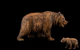 A Black Forest Bear - Carved Bear In Roaming Position, Height 4.5 Inches Length 8 Inches.