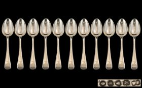 Antique Period - Collection of ( 11 ) Eleven Matched Sterling Silver Dessert Spoons.