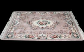 Woollen Aubusson Chinese Style Floral Washed Wool Rug, measures 6' x 4'.