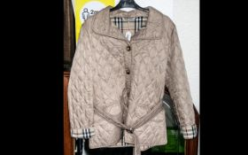 Burberry of London Ladies Jacket, beige, diamond quilted style with belt, two flap pockets, and