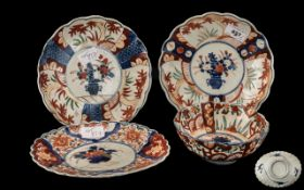 "Four Antique Imari Dishes comprising a pair of Lobed shaped plates 7"" diameter; a fluted Imari bowl,"