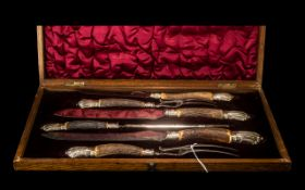 An Antique Carving Set in fitted silk lined velvet case.