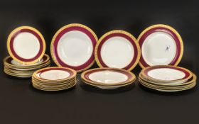 Set of Worcester Dinner Plates, various sizes, with a gilt jewelled maroon border.