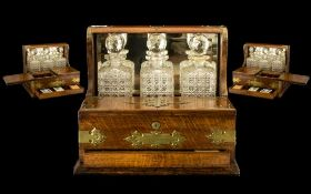 Fine Quality Oak Cased Antique Tantalus Compendium with mirror back and brass carrying handles