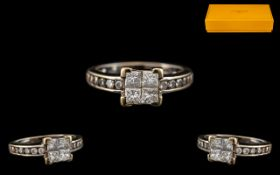 18ct White Gold Diamond Ring set with four central Princess cut diamonds between diamond cut