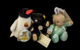 Two Small Steiff Toys, comprising a black Steiff Teddy Bear 1912 with moveable limbs and glass eyes,