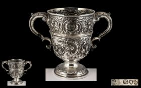 Victorian Period - Impressive and Fine Quality Sterling Silver Twin Handle Embossed Loving Cup.