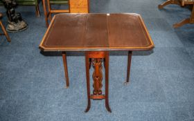 An Edwardian Mahogany Sutherland Table, of typical form, with satinwood inlay, square tapering legs,