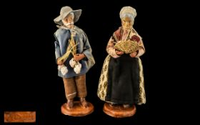 Pair of Pottery Figures of a Farmer and Wife, dressed in traditional garb, signed M.Decorg; 10