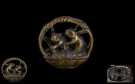 Oriental Boxwood Netsuke In The Form Of Rabbits Playing In A Basket. Signed To Base.