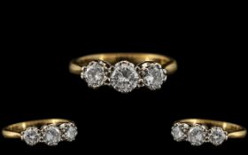 18ct Gold and Platinum - Attractive 3 Stone Diamond Set Ring In a Gallery Setting. The 3 Round
