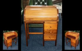 Child's Beechwood Roll Top Desk with three short drawers, mid century, made by Pegasus.