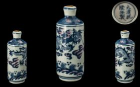 Chinese Blue and White Antique Snuff Bottle, the body decorated with a swirling dragon,
