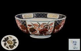 Japanese Imari Bowl of typical palette with gilt highlights; character marks to the base;