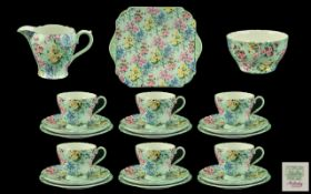A Shelley 21 Piece Melody Tea Service comprising 6 trios, sugare, cream and bread and butter plate.