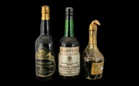 A Bottle of Harvey's Bristol Cream Sherry a bottle of Williams & Humbert Sherry;