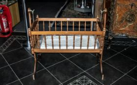 A 20th Century Babies Swinging Cradle mahogany finish, height 36'', length 38''.