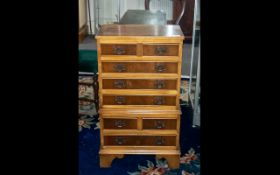 Small Reproduction Yew Wood Chest on Chest, with brass fret work handles,