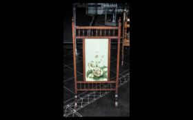 A Victorian Mahogany Fire Screen, the front with painted panel, square supports with turned gallery.