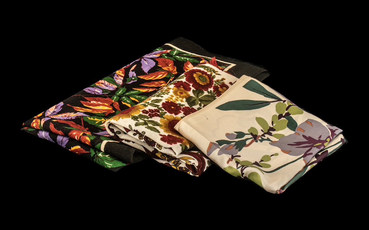 """Collection of Four Liberty of London Scarves comprising a fine wool 25"""" square floral scarf in"""