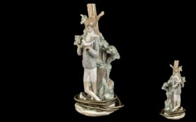 Lladro Handpainted Figural Porcelain Lamp - 'Boy Holding a Dove' standing by a tall tree. Model no.