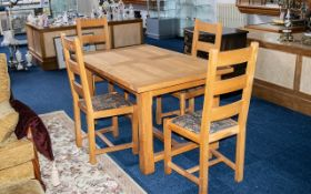 Contemporary Oak Dining Table & Four Matching Chairs. Oak table with four legs and stretcher, chairs
