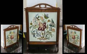Edwardian Walnut Framed Fire Screen with a hand stitched embroidered panel depicting flowers,