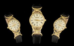 Gucci 6000 Ladies Gold Plated Wrist Watch in original case with black leather strap.