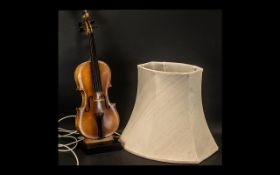 A Contemporary Table Lamp in the form of