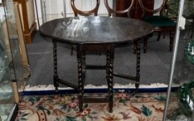 Edwardian Oak Gate-Leg Table supported on barley twist legs, with cross stretchers; 30 inches (