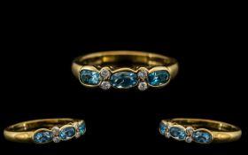 18ct Gold - Attractive Aquamarine and Diamond Set Ring of Pleasing Design.