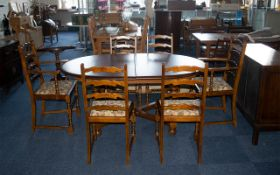 Teak Pull-Out Dining Table on baluster-shaped legs with cross stretchers.