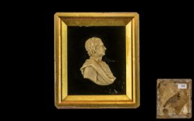 Early 19th Century Carved Wax Miniature of a Gentleman in classical garbe,