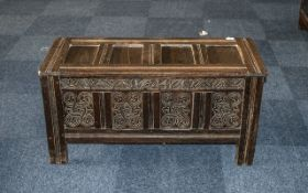 An Oak Panelled Coffer of traditional peg construction, panelled hinged top, front, sides and