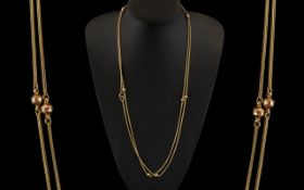 Antique Period - Attractive 9ct Gold Muff Chain, Foxtail and Bauble Design.