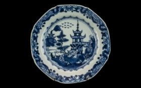 Chinese Antique Blue & White Nanking Plate, depicting a pagoda in a landscape. Circa 1800s.