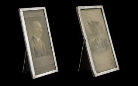 A Pair of Matching Rectangular Shaped Silver Photo Frames with Mahogany Backs and Struts.