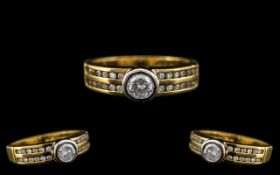 18ct Two Tone Gold Attractive Diamond Set Dress Ring of Contemporary Design.
