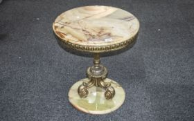 Onyx Topped Round Side Table supported by a central brass column with cast shaped legs,