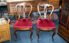 Pair of Victorian Mahogany Balloon Backed Chairs on cabriole legs, with red drop in seats.