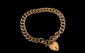 Late Victorian Period 9ct Gold Curb Bracelet with Attached 9ct Gold Heart Shaped Padlock.