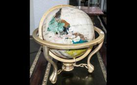 """A Modern Gem Set Terrestrial Globe with Gilt Gimbel of typical form, diameter 13""""."""
