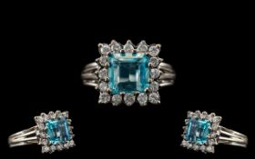 18ct White Gold Attractive Diamond and Aquamarine Set Dress Ring of Square Form. Marked 18ct.
